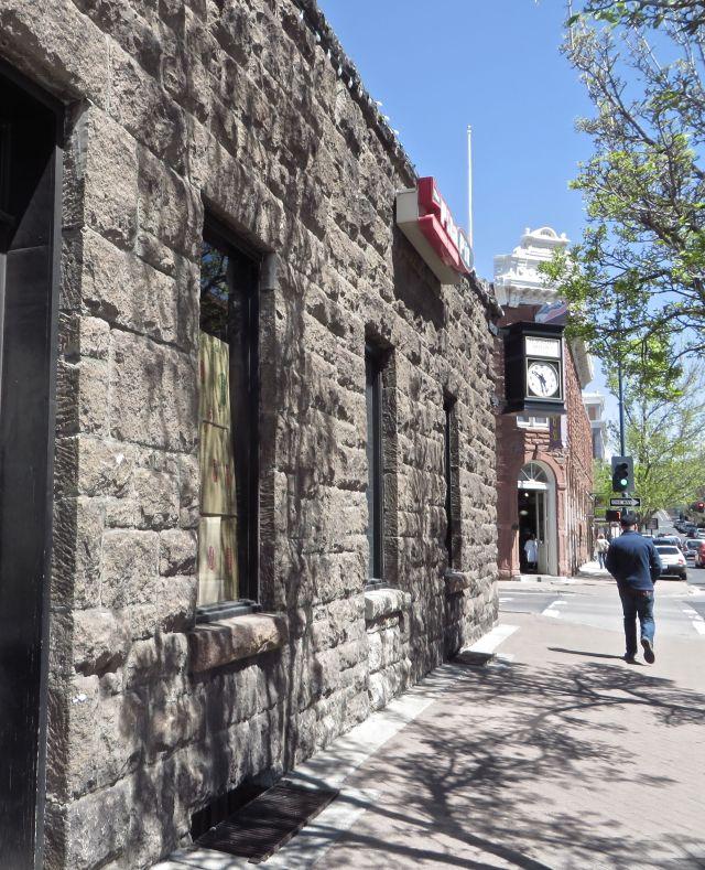 The David Babbitt Building was built in 1907 of split-faced blocks of volcanic rock.